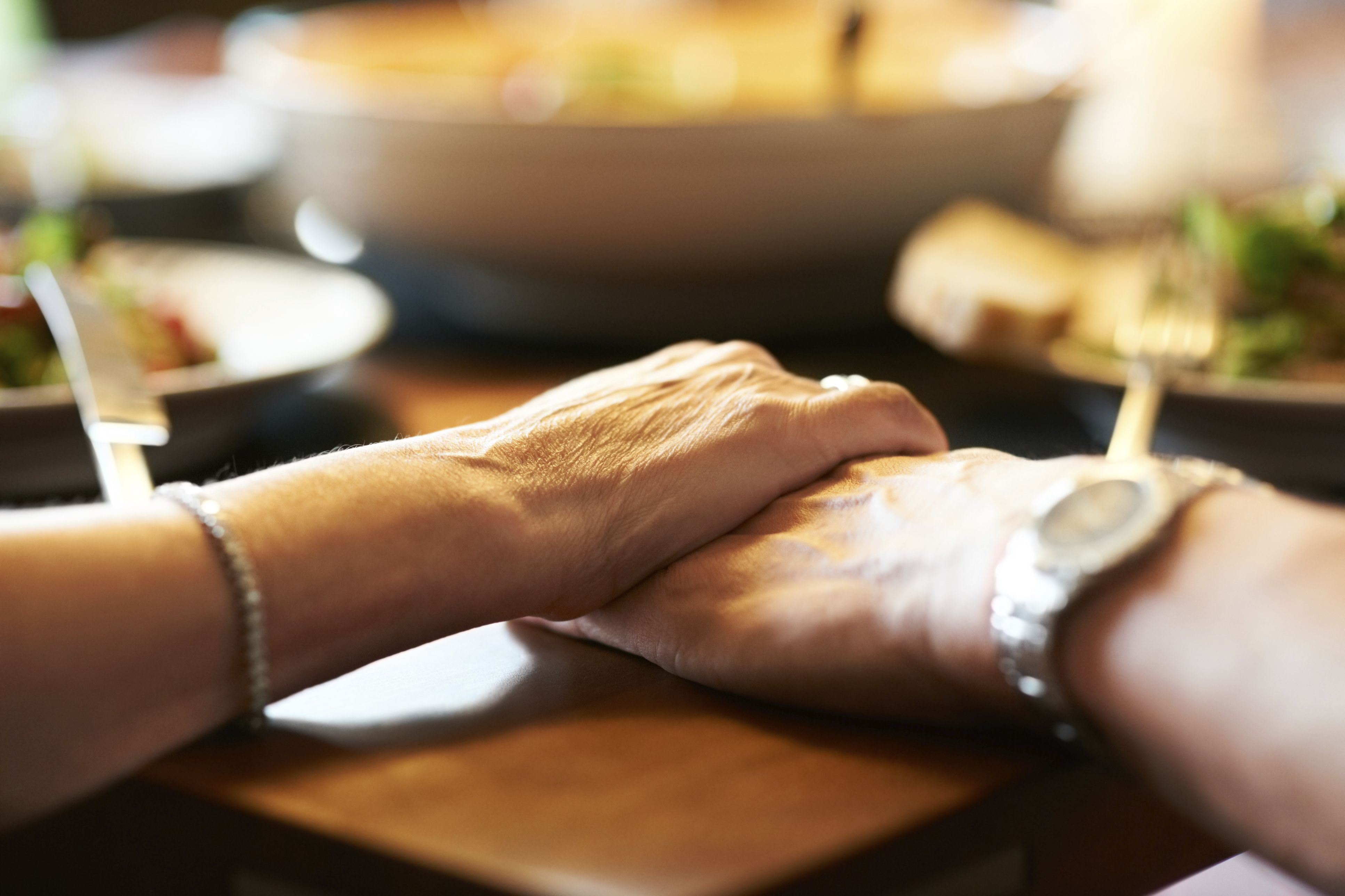 176678753-hand-holding-dinner-56a514d65f9b58b7d0dac685